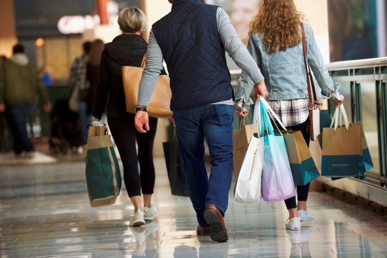 Image: FILE PHOTO: Shoppers carry bags of purchased merchandise at the King of Prussia Mall, United States' largest retail shopping space, in King of Prussia