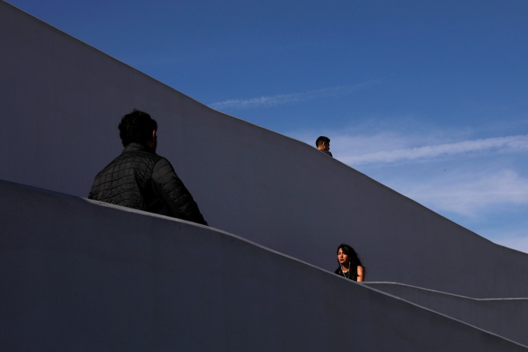 Image: People are seen at Pedwest border crossing entering into to Mexico at the San Ysidro point of entry in Tijuana