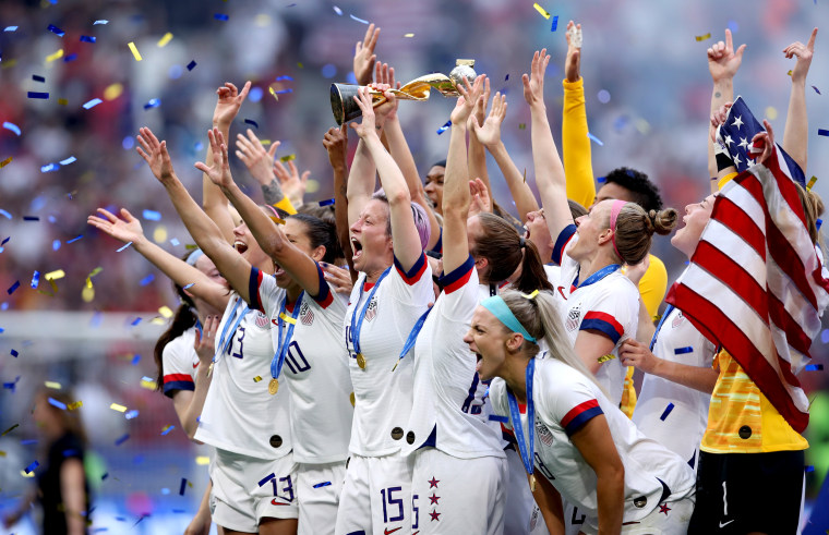 Image: Megan Rapinoe lifts the FIFA Women's World Cup trophy after the United States defeated the Netherlands at the Stade de Lyon on July 7, 2019.