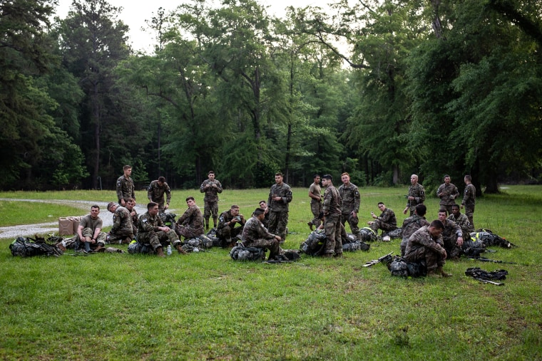 Army Ranger trainees rest after the 12-mile march during which they wore sensors to measure their core temperatures and heart rates.