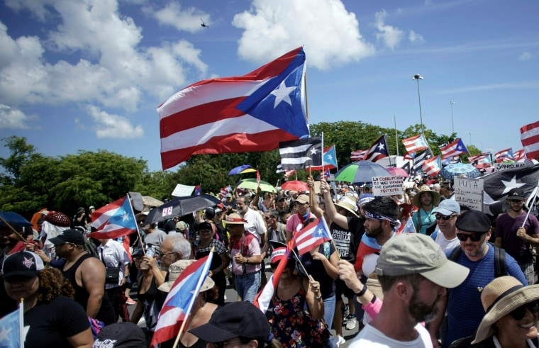 Image: People march across the Las Americas Highway as protests continue in San Juan, Puerto Rico, on July 22, 2019.