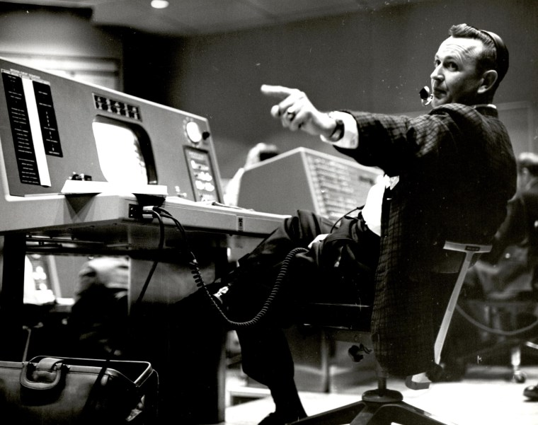 Christopher Kraft works at his console inside the Flight Control area at Mercury Mission Control in Houston.