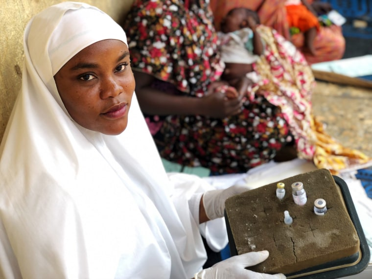 Aisha Shuaibu Mohammed holds the oral and injectable polio vaccines