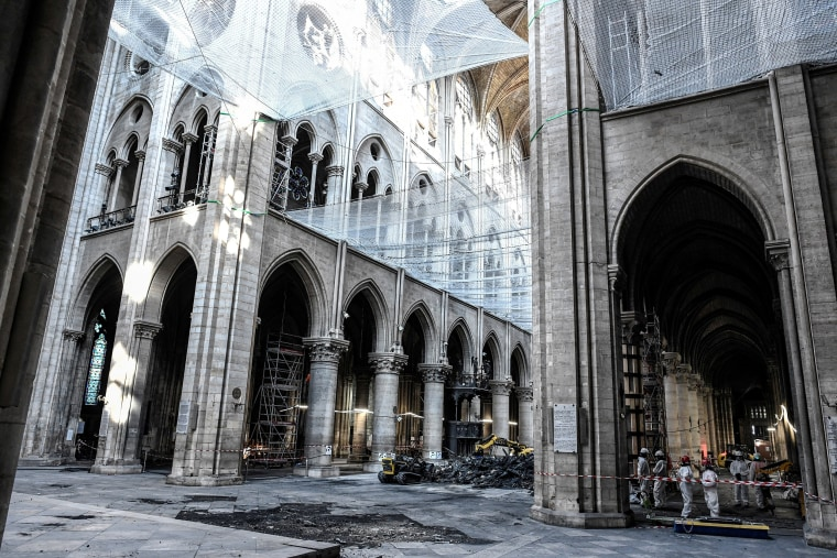 Image: General view of damage on the nave and rubble is pictured during preliminary work in the Notre-Dame Cathedral, three months after a major fire, in Paris