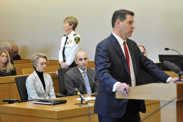 Michelle Carter appears in Taunton District Court in Taunton, Massachusetts on Feb. 11, 2019, for a hearing on her prison sentence as lawyer Joe Cataldo speaks at the podium.