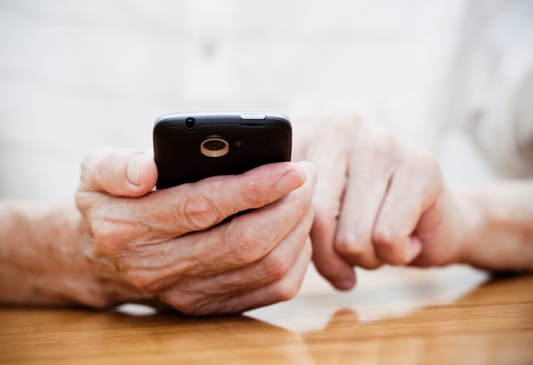 Image: Old man using smart phone