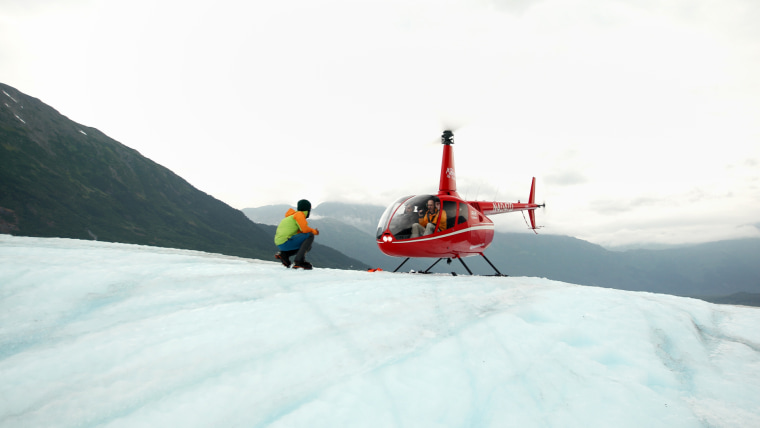 A helicopter lands on the Spencer Glacier in the Chugach National Forest, located in southern Alaska.  The ice has melted so much in the last five years that visitors must land on the ice instead of hiking there.