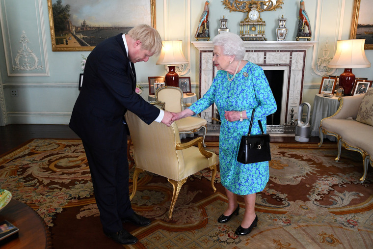 Image: Boris Johnson arrives at Buckingham Palace in London for an audience with Queen Elizabeth II, in London