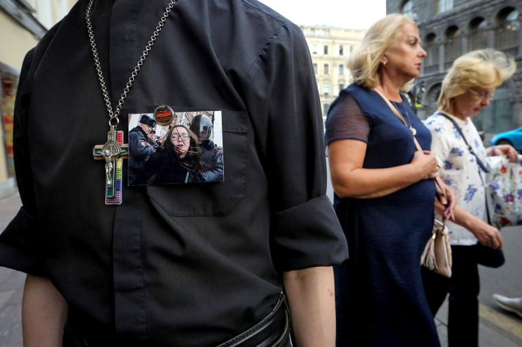 Image: A supporter of LGBT community attends a rally after a murder of Elena Grigoryeva, activist for LGBT rights, in Saint Petersburg