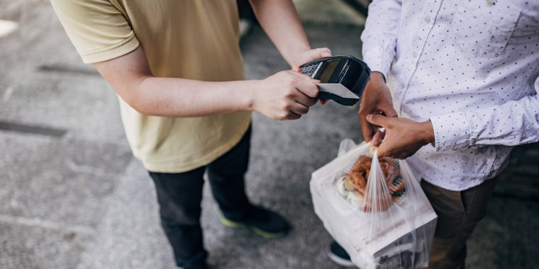 Paying takeout food with credit card