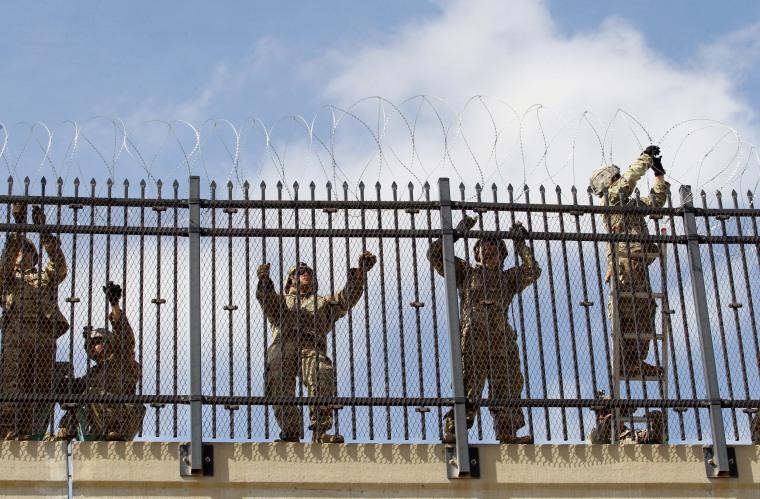 Image: FILE PHOTO: FILE PHOTO: U.S. Army soldiers install a razor wire fence near the U.S-Mexico border in McAllen