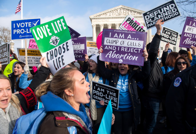 "Image: Anti-abortion activists at a ""March for Life\"" event outside of Supreme Court"