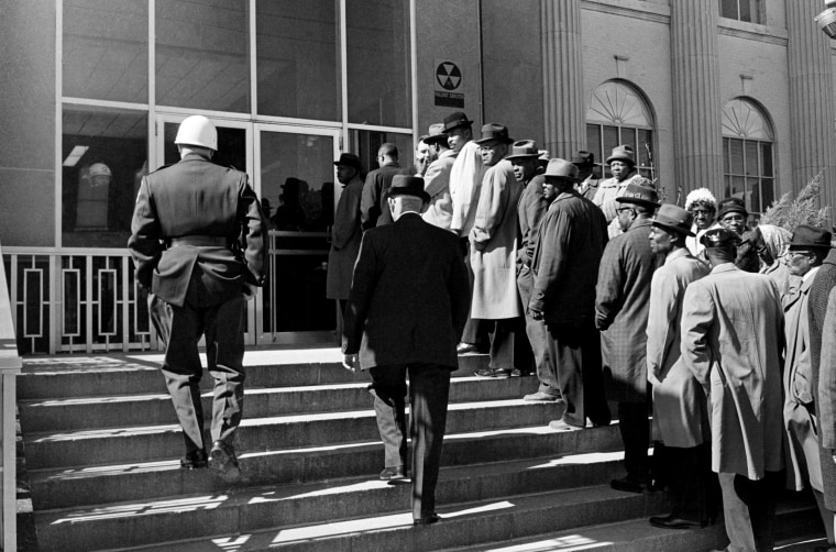Image: A long line of African-Americans line up to register to vote outside the Selma courthouse in Alabama on Feb. 15, 1965.