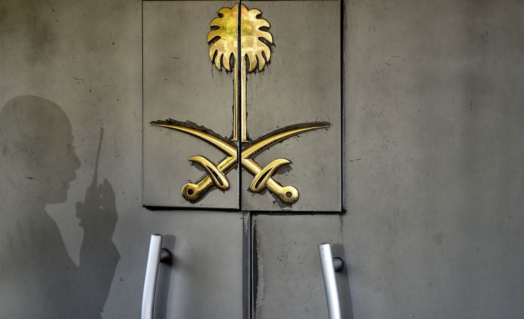 The shadow of a security member of the consulate is seen on the door of the Saudi Arabian consulate on Nov. 1, 2018 in Istanbul.