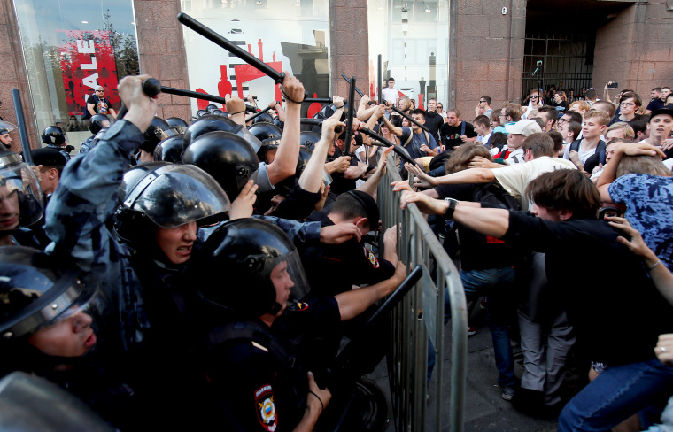 Image: Demonstrators clash with Russian police during a rally for election fairness in Moscow on July 27, 2019.