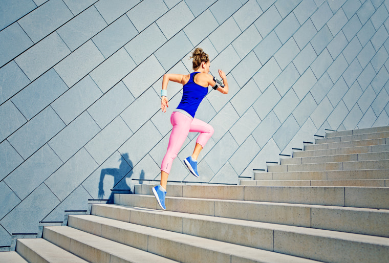 Image: Girl running on the stairs and listening to music