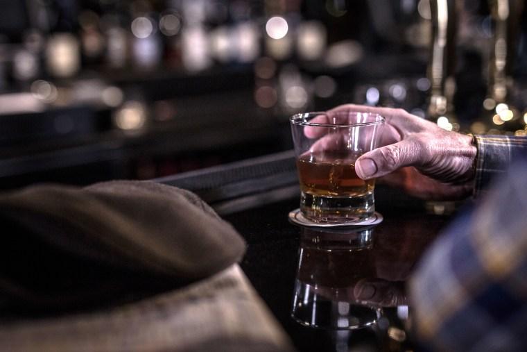 Image: Man drinking at bar