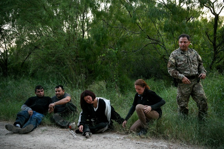 Image: Migrants from Mexico, El Salvador, China and Colombia are detained by U.S. Border Patrol agents after illegally crossing the Rio Grande near Mission