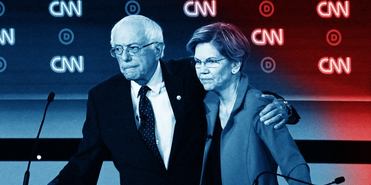 Image: Bernie Sanders and Elizabeth Warren hug at the end of the first round of the second Democratic primary debate in Detroit on July 30, 2019.
