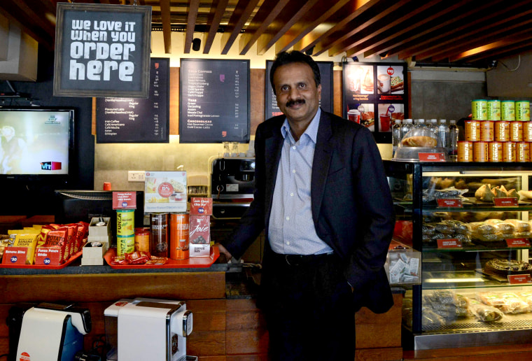 Image: V.G. Siddhartha, owner of the Cafe Coffee Day chain, inside one of the shops in Ahmedabad, India, in 2015.