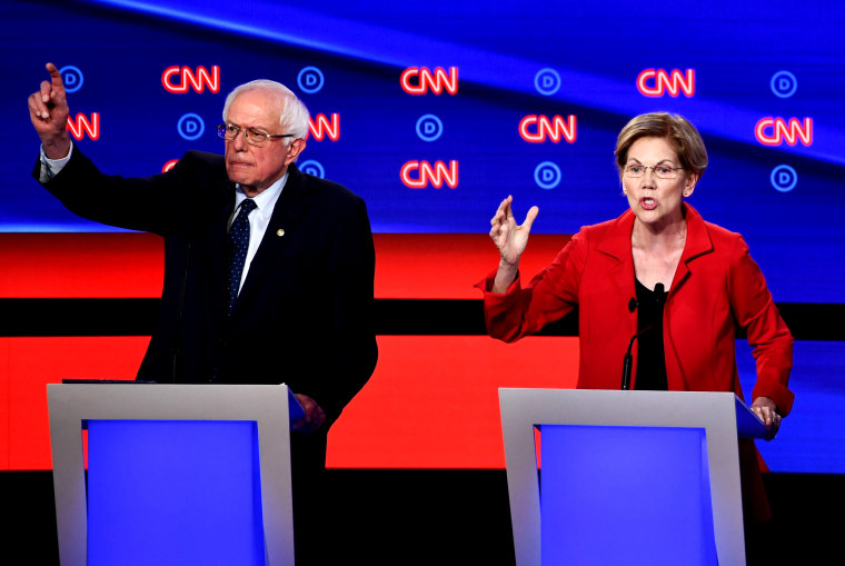 Image: Sens. Bernie Sanders and Elizabeth Warren speak during the first round of the second Democratic primary debate at the Fox Theatre in Detroit on July 30, 2019.