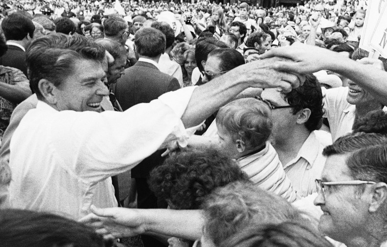 Republican presidential candidate Ronald Reagan moves through the crowd shaking hands at the Neshoba County Fair