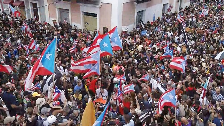 People celebrate in San Juan, Puerto Rico after Governor Ricardo Rossello has officially stepped down, on Aug. 2, 2019.