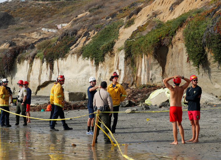 Image: Emergency responders attend to a cliff collapse at a beach in Encinitas, California