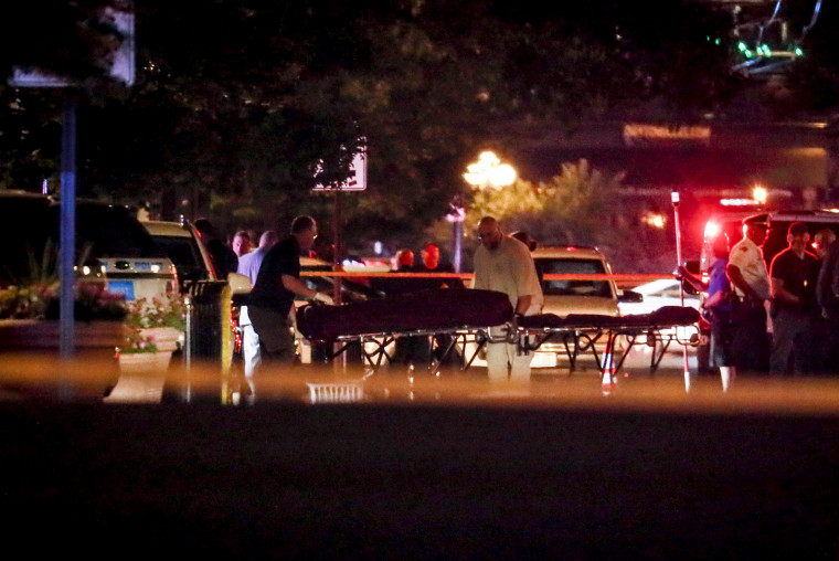 Image: Bodies are removed from the scene of a mass shooting in Dayton, Ohio, that left at least nine dead on Aug. 4, 2019.