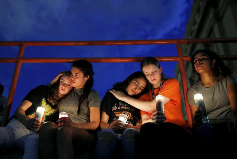 Image: Melody Stout, Hannah Payan, Aaliyah Alba, Sherie Gramlich and Laura Barrios comfort one another at a vigil for victims of a mass shooting in El Paso, Texas, that left at least 20 dead on Aug. 3, 2019.
