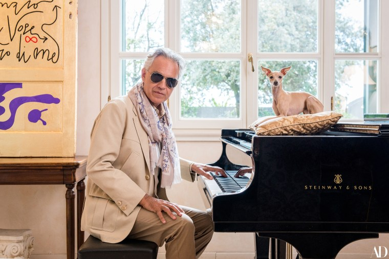 Opera singer Andrea Bocelli at home with his dog, Katarina.
