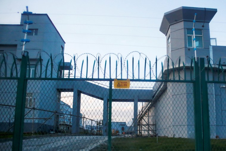 Image: A perimeter fence is constructed around what is officially known as a vocational skills education center in Dabancheng