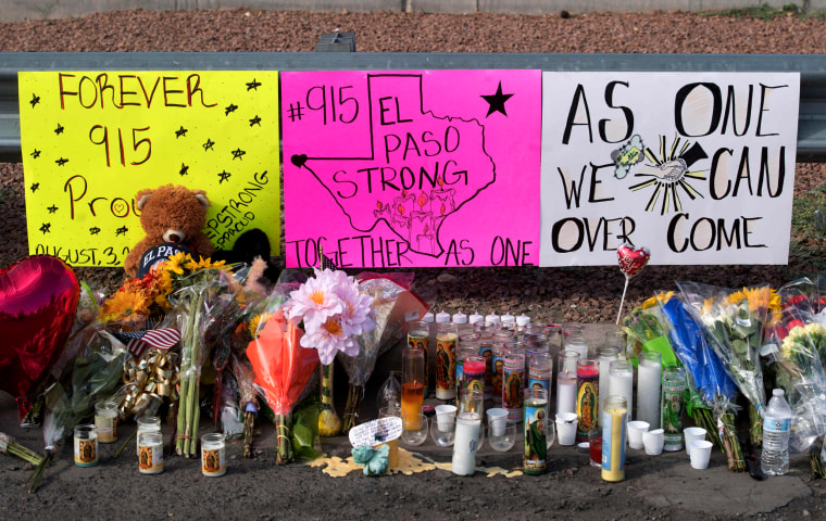 Image: Flowers and signs at a makeshift memorial for the victims of a mass shooting in El Paso, Texas, on Aug. 5, 2019.