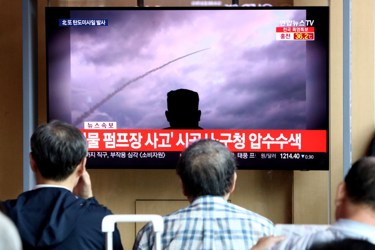 Image: People watch a TV showing a file image of a North Korea's missile launch at the Seoul Railway Station on Aug. 6, 2019 in Seoul, South Korea.