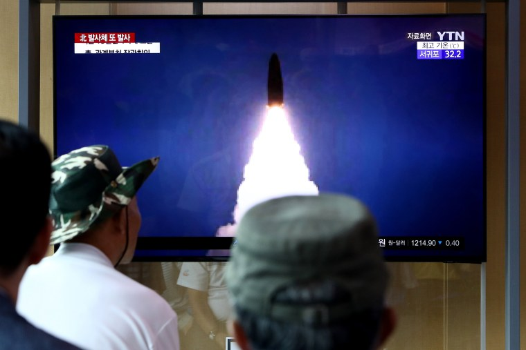 Image: People watch a TV showing a file image of a North Korea's missile launch at the Seoul Railway Station