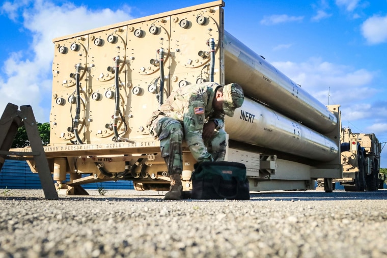 Image: U.S. Army soldier looks in his tool bag during a routine maintenance inspection of a THAAD weapon system on Andersen Air Force Base