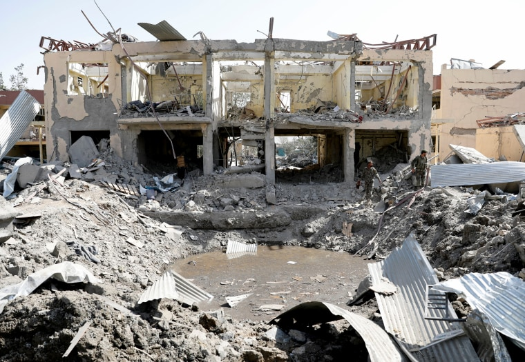 Image: Afghan National Army soldiers inspect a blast site in Kabul on Aug. 7, 2019.