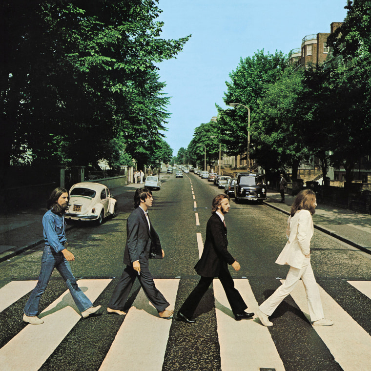 Image: Members of the Beatles, George Harrison, Paul McCartney, Ringo Starr, John Lennon, cross Abbey Road in London