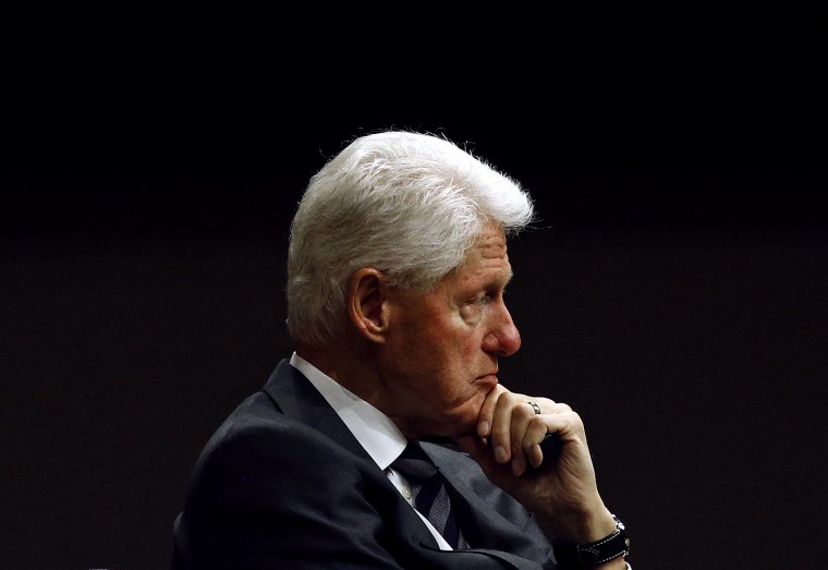 Image: Former President Bill Clinton listens at a panel in Baltimore in 2017.