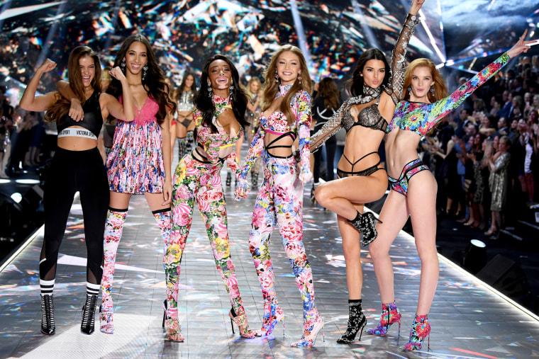 Image: Barbara Palvin, Yasmin Wijnaldum, Winnie Harlow, Gigi Hadid, Kendall Jenner and Alexina Graham walk the runway at the 2018 Victoria's Secret Fashion Show in New York.