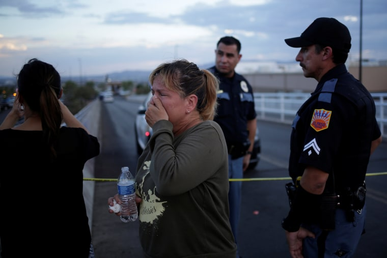 Image: A woman reacts after a mass shooting at a Walmart in El Paso