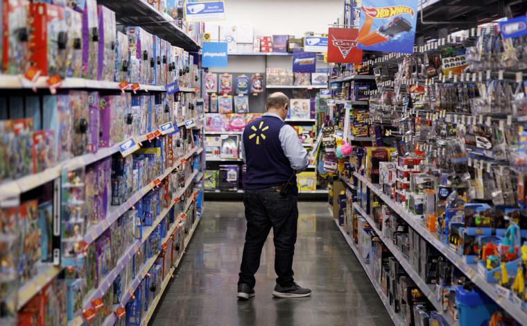 An employee scans items at a Walmart Inc. store in Burbank, Californi