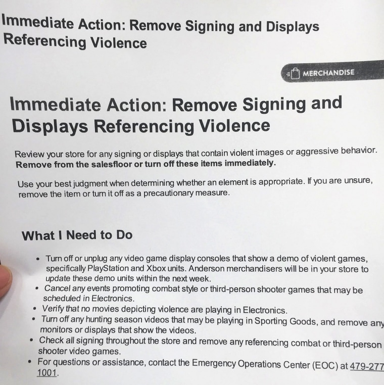 """Walmart this week sent workers in its stores a notice telling them to take """"immediate action,"""" to """"remove signing and displays referencing violence."""""""