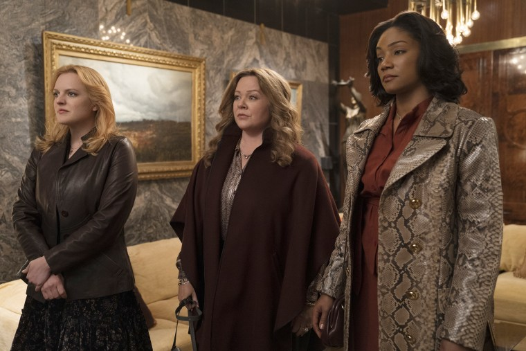 "Elisabeth Moss as Claire, Melissa McCarthy as Kathy and Tiffany Haddish as Ruby in a scene from ""The Kitchen."""