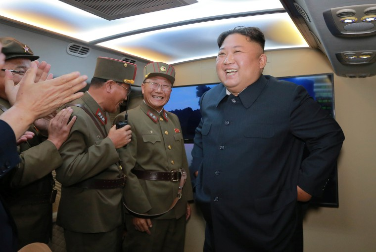Image: North Korean leader Kim Jong Un smiles as he guides missile testing at an unidentified location in North Korea