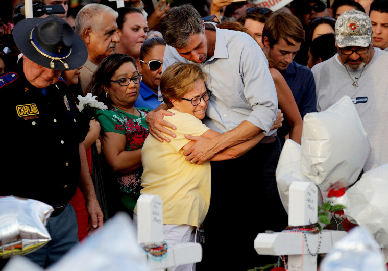 Image: Beto O'Rourke hugs a woman at a memorial honoring the victims of a mass shooting in El Paso, Texas, on Aug. 7, 2019.