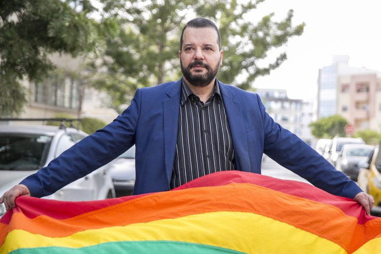 LGBT activist Mounir Baatour holds a rainbow flag after submitting his candidacy for the upcoming early presidential elections in Tunis, Tunisia on Aug. 8, 2019.