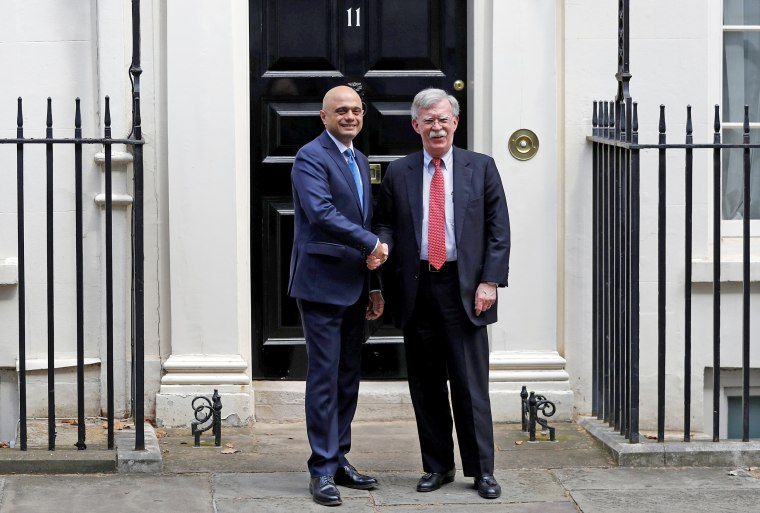 Image: Britain's Chancellor of the Exchequer Sajid Javid shakes hands with U.S. National Security Advisor John Bolton at Downing Street in London
