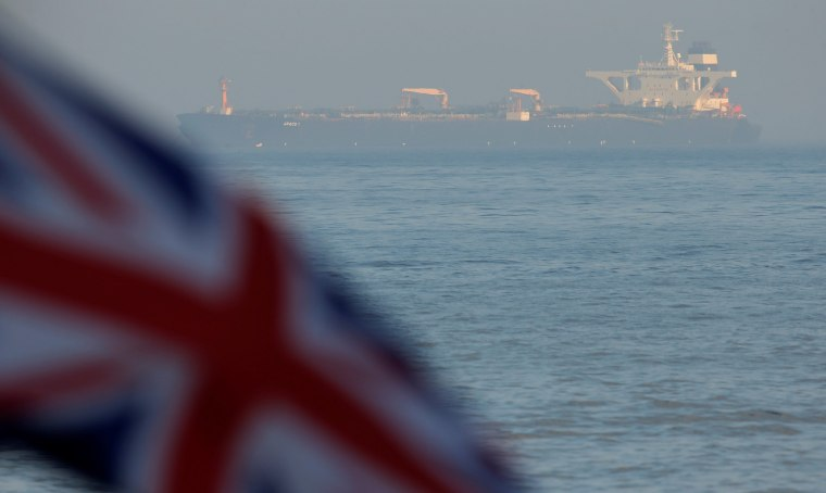 Image: The Iranian oil tanker Grace 1 sits anchored after it was seized in July by British Royal Marines off the coast of the British Mediterranean territory on suspicion of violating sanctions against Syria, in the Strait of Gibraltar