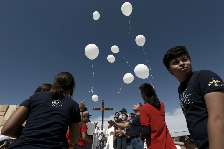 Image: Mourners release balloons during a mass remembering the victims of an El Paso mass shooting that left 22 dead in Ciudad Juarez, Mexico, on Aug. 10, 2019.